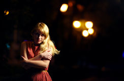 Lonely girl on dark night street Stock Photo