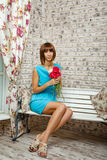 Lonely girl with flowers Royalty Free Stock Photography
