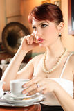 Lonely girl having a cup of tea Royalty Free Stock Images