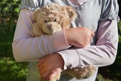 Lonely girl holding a teddy bear as her best friend Royalty Free Stock Photography