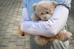 Lonely girl holding a teddy bear as her best friend. Lonely girl holding a teddy bear as of her best friend Stock Image