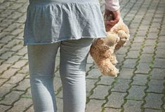 Lonely girl holding a teddy bear as her best friend Royalty Free Stock Photo