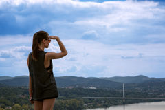 Lonely girl looking far away distance Stock Photography