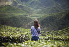 Lonely girl in mountains Stock Images