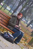 Lonely girl in a park Stock Images