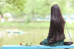 Lonely girl in park Stock Photos