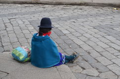 Lonely girl on Riobamba, Ecuador. Lonely girl on the sidewalk, waiting for the future Royalty Free Stock Photo