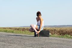 The lonely girl on road Stock Image
