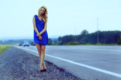 Lonely girl on the roadside Royalty Free Stock Images