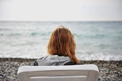 Lonely girl at the sea Stock Photography
