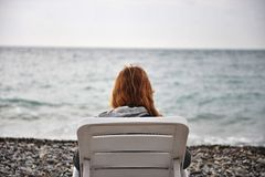 Lonely girl at the sea Stock Image