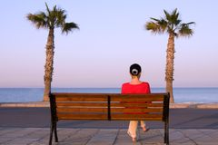 Lonely girl sits on a bench Royalty Free Stock Photography