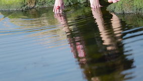 A Lonely Girl Sitting By The River stock footage