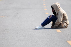 Lonely Girl Sitting on the Road Royalty Free Stock Photography