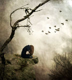 Lonely girl sitting on a rock in sorrow. Sad girl sitting on a cliff one,digital Art,emotional Royalty Free Stock Images