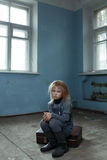 Lonely girl sitting on the suitcase Stock Photography
