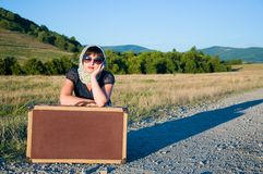 Lonely girl with suitcase Stock Photography