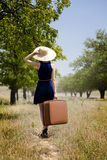 Lonely girl with suitcase at countryside. Stock Photography