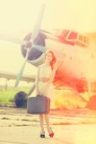 Lonely girl with suitcase Royalty Free Stock Photography