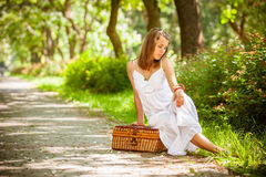 Lonely girl with suitcase at park Royalty Free Stock Image