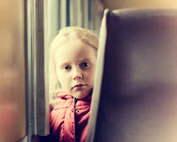 Lonely girl in a train Stock Images
