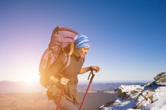 Lonely girl travels through mountains. Stock Images