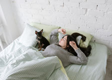 Lonely girl wake up with dog Royalty Free Stock Images