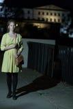 Lonely girl walking at night Stock Photos