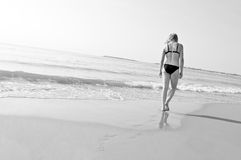 Lonely girl walks on the beach Royalty Free Stock Photos