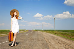 Free Lonely Girl With Suitcase At Country Road. Royalty Free Stock Image - 19374016