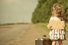 Lonely Girl With Suitcase Standing About Road Royalty Free Stock Images