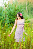 Lonely girl in the woods. Beautiful girl in a field of flowers Stock Photos
