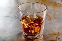 Lonely glass with whisky Royalty Free Stock Photography