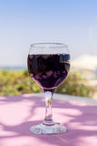 Lonely glass of wine on sunny summer day. Lonely glass of wine on sunny summer background stock photo