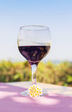 Lonely glass of wine on sunny summer day. Lonely glass of wine on sunny summer background stock images