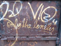 Only the lonely graffiti. On rusted metal royalty free stock photo