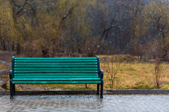 Lonely green bench. Stock Photo