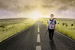 Lonely guitarist walking on road 4 Stock Photography