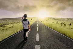 Lonely guitarist walking on road 2 Stock Image
