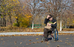 Lonely handicapped man in a wheelchair Stock Photography