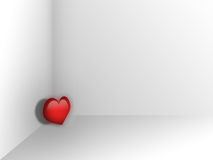 A lonely heart. In a white room Stock Images