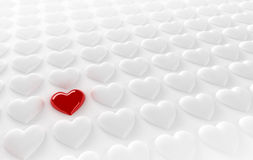 Lonely heart. Red heart in between many white hearts Stock Photography