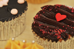 Lonely Heart Cupcake. Macro image with focus on the heart shape Royalty Free Stock Photography