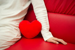 Lonely heart on sofa - Valentine and loneliness. Lonely heart and woman on sofa - Valentine and loneliness Stock Photo