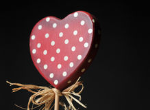 Lonely heart, valentines day. Growing love, red heart on black background Royalty Free Stock Images
