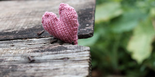 Lonely heart on wooden background Stock Photography