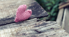 Lonely heart on wooden background Royalty Free Stock Photography