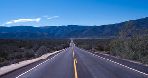 Lonely highway in California. A lonely highway right through the middle of Death Valley, California stock photos