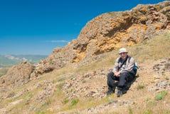 Lonely hiker having short rest on Kara-dag  natural reserve, Eastern Crimea Stock Photography