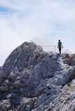 Lonely hiker on a mountain ridge Royalty Free Stock Image